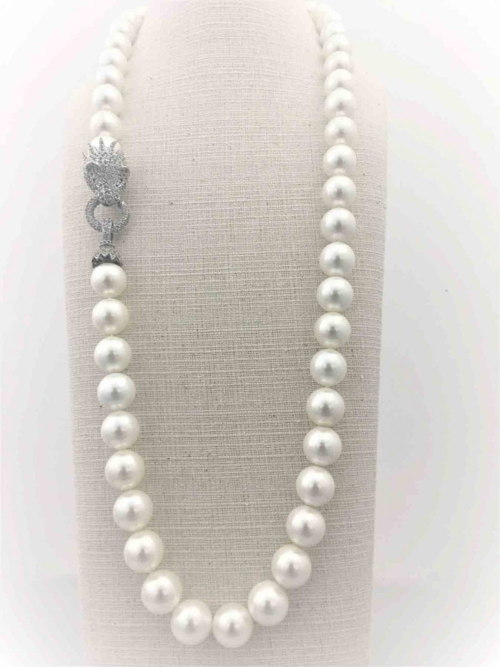 16mm Mother of Pearl Necklace with a large White Topaz encrusted Lion Head made of STG Silver (70cm)